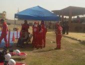 رجال الإطفاء ينفذون بيانا عمليا لحريق مبنى وإنقاذ أشخاص أعلاه