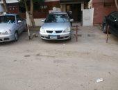 شكوى من استغلال شارع الخليفة المطيع فى مدينة نصر بأعمدة لركن السيارات