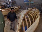 إزدهار صناعة الزوارق الخشب فى مدينة النجف العراقية (صور)
