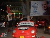صور.. لافتات على السيارات لحث المواطنين على المشاركة بالانتخابات فى بورسعيد