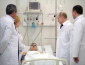 صور.. بوتين يلتقى أسر ضحايا حريق مركز تجارى ويطمئن على المصابين
