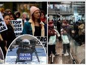 """صور.. العالم هذا الصباح.. احتجاجات أمام برج ترامب بشيكاغو تحت شعار """"لا لعنف الشرطة"""".. فوضى بسكك حديد فرنسا بسبب بدء إضراب الموظفين.. الحزن يضرب جنوب أفريقيا بعد وفاة زوجة الزعيم الراحل نيلسون مانديلا"""