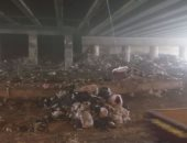 صور.. اضبط مخالفة.. انتشار القمامة يعيق المرور بشوارع الوراق