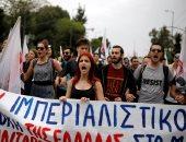 """صور.. آلاف اليونانيين يتظاهرون تحت شعار """" الأمريكيون قتلة """" دعما لسوريا"""