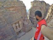 """على العجلة.. محمد نوفل """"ابن بطوطة"""" فى رحلة من مصر لروسيا لتشجيع المنتخب"""