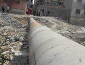 صور.. مد خط للصرف الصحى على شاطئ الدخيلة غرب الإسكندرية