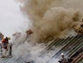 صور.. اندلاع حريق هائل بأحد البنوك فى سويسرا