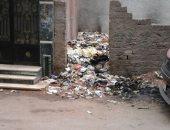 صور.. قارئ يشكو من تراكم القمامة بشارع المغربى فى المنصورة
