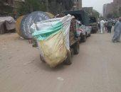 نظافة الجيزة تضبط عربات كارو تلقى مخلفات بناء بشارع فى بولاق
