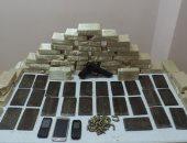 إيداع أمناء شرطة متهمين بتسريب معلومات لتجار مخدرات بالقاهرة قفص الاتهام