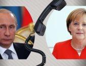 بوتين وميركل يناقشان سبل تسوية الأزمة السورية