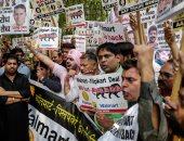 """صور..مظاهرات بالهند احتجاجا على بيع أسهم """"فليبكارت"""" لصالح شركة أمريكية"""