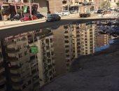 صور.. قارئ يشكو من انتشار مياه الصرف الصحى بشارع اللبينى بالجيزة