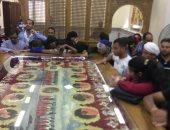 """صور.. دفن رفات شهداء ليبيا بكنيسة """"الإيمان والوطن"""" بالمنيا"""