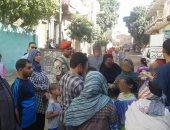 """محافظ أسيوط : توزيع كراتين مواد غذائية """" تحيا مصر """" بأسعار مخفضة"""