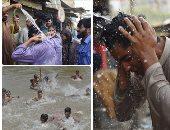 صور.. موجة حر شديدة تضرب العالم.. درجات الحرارة تصل لـ44 بباكستان والهند والسعودية والسودان والكويت.. الأرصاد تحذر من التعرض للشمس.. المواطنون يواجهون الصيف باللجوء للشواطئ.. ووفاة 65 شخصا فى كراتشى الباكستانية