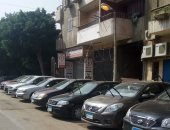 قارئ يرصد ترك أعمدة الكهرباء مضاءة نهارا فى شارع محمد شكرى بالزيتون