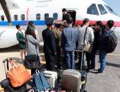 صور.. وصول صحفيين كوريين جنوبين لموقع التجارب النووية فى بيونج يانج