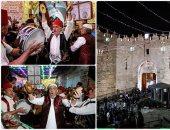 """صور..الفلسطينيون يزينون """"باب دمشق"""" بالقدس احتفالا بالليلة الثامنة من رمضان"""