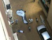 """""""الاستعلام عن حالتها الصحية""""..التحقيق فى سقوط فتاة عارية من شقة شابين بأكتوبر"""