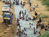 صور.. تزايد حالات الإغماء مع استمرار الموجه الحارة فى باكستان