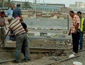 """صور.. إصلاح """"قضبان"""" مزلقان """"الرسوة"""" لاستئناف العمل بمحطة سكة حديد بورسعيد"""