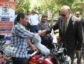 محافظ القاهرة يسلم 24 دراجة بخارية لمتحدى الإعاقة - صور