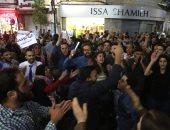 صور تفريق قوات الأمن الفلسطينية مظاهرة فى رام الله للتضامن مع موظفى غزة