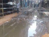 أهالى شارع المزرعة بشبرا الخيمة يشكون من انتشار مياه الصرف الصحى