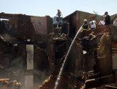 شهود عيان: انهيار عقار بولاق أبو العلا بسبب حريق نشب به