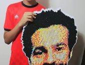 محمد خالد يصنع بورتريه لمحمد صلاح بألف قطعة ورقية