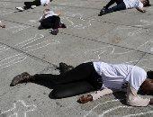صور.. نشطاء أسبان يطالبون بحق اللجوء لضحايا العنف بطريقتهم الخاصة