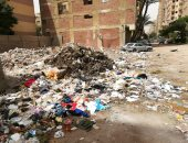 قارئ يرصد بالصور.. القمامة تحاصر الجيزة وغياب اهتمام المسئولين