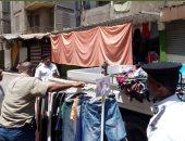 حملة مرافق تزيل إشغالات وتغلق محلات مخالفة بميدان المنيب والهرم