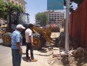 صور.. مجلس مدينة الأقصر يرفع 40 طن تراكمات من شارع خالد بن الوليد