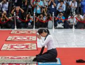 صور.. زعيمة ميانمار تشارك فى إحياء اليوم الوطنى للشهداء