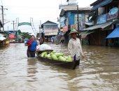 صور.. آلاف السكان يهربون من مياه الفيضانات فى ميانمار