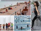 الحر يجوب العالم والسكان يفرون إلى الشواطئ والمنتزهات