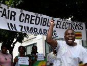 صور.. عشرات الزيمبابويين يتظاهرن فى لندن احتجاجا على فوز منانجاجوا بالرئاسة