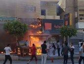 قوات الدفاع المدنى تحاول السيطرة على حريق شب فى مخزن ملابس بكفر الشيخ