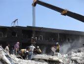 صور.. إزالة الأنقاض بعد انفجار مستودع أسلحة فى سوريا