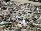 شكوى من تراكم القمامة بموقف المسلة الجديدة فى المطرية