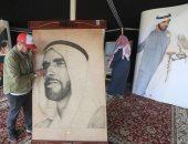 شاهد.. لوحة للشيخ زايد من المسامير المذهبة والخيوط فى مهرجان الألعاب البدوية