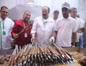 """الشيفان """"الشربينى"""" و""""حسونة"""" يعدان الطعام للحجاج المصريين بالسعودية.. صور"""