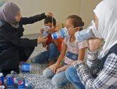 صور .. السوريون يستعدون لمعركة إدلب بأقنعة الغاز من الفحم والبلاستيك