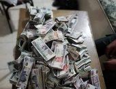 الصحة العالمية: لا يوجد دليل على نقل كورونا عن طريق العملات المعدنية والورقية