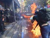 صور.. اشتباكات بين متظاهرين والأمن الأوكرانى احتجاجا على تسليم داعشى لموسكو