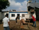 حملة لإزالة إشغالات أكشاك شارع السودان بالعجوزة وأخرى للأبنية المخالفة..صور