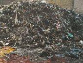 شكوى من انتشار تلال القمامة فى شارع الترولى بالمطرية