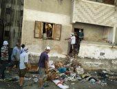 فيديو وصور.. حملة نظافة فى بورسعيد تكتشف تحول شقة لمقلب قمامة